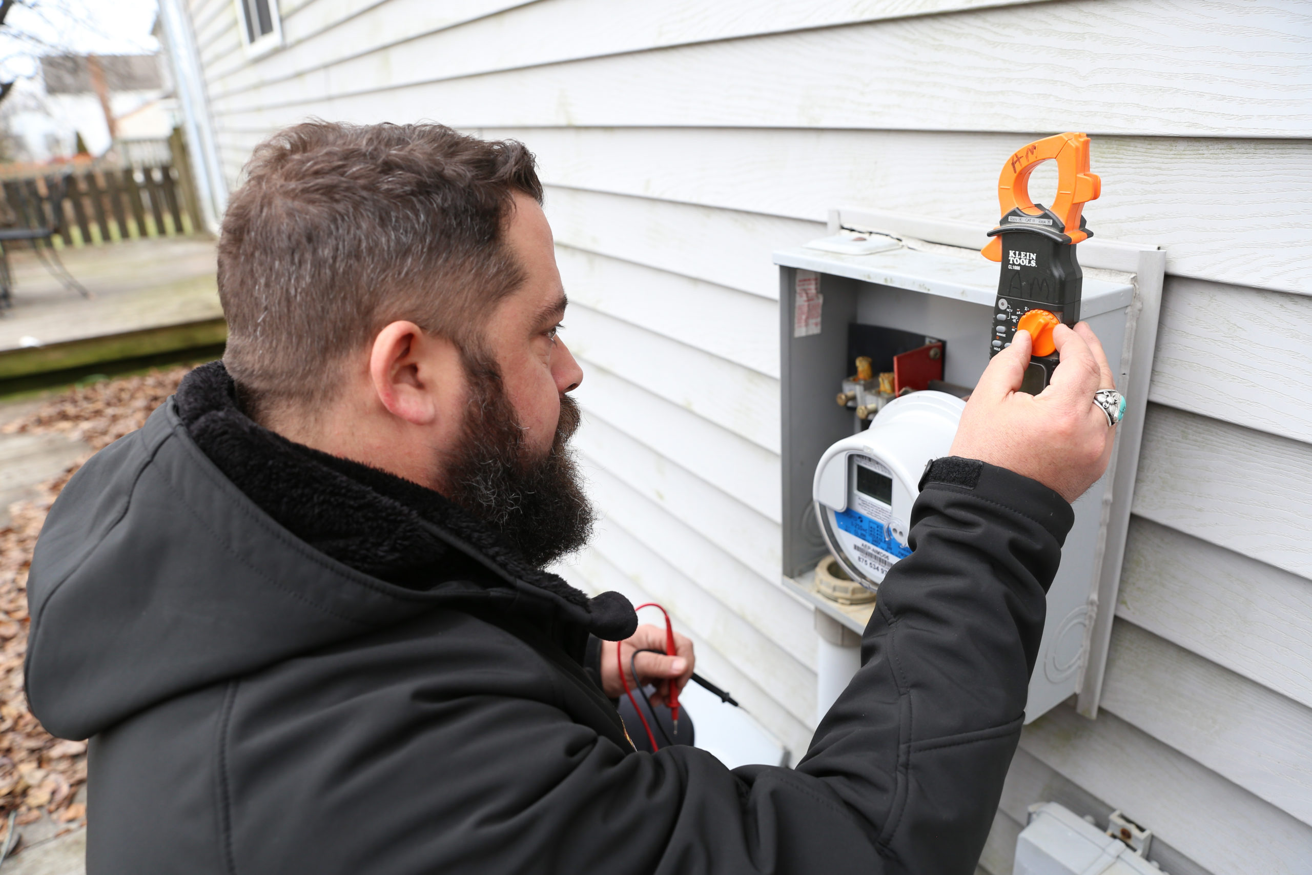 Electrician working on outdoor power box